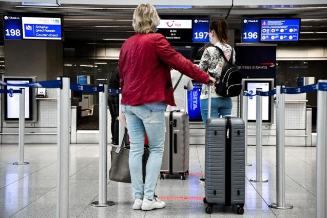 Travellers at a Spanish airport check-in