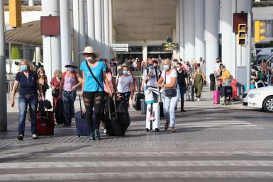 Tourists arriving at Palma airport in August.