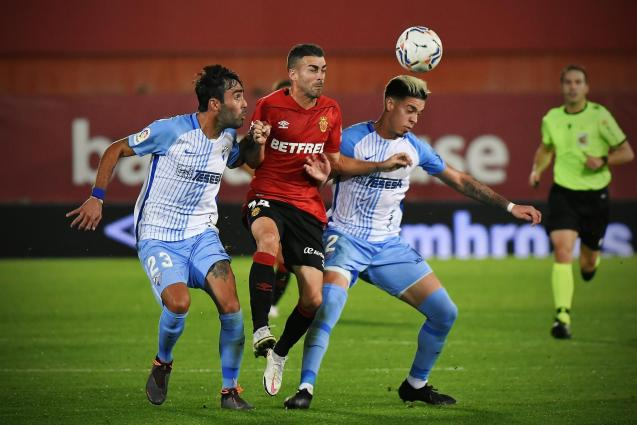 """Dani Rodriguez is """"sandwiched"""" between two Malaga players"""