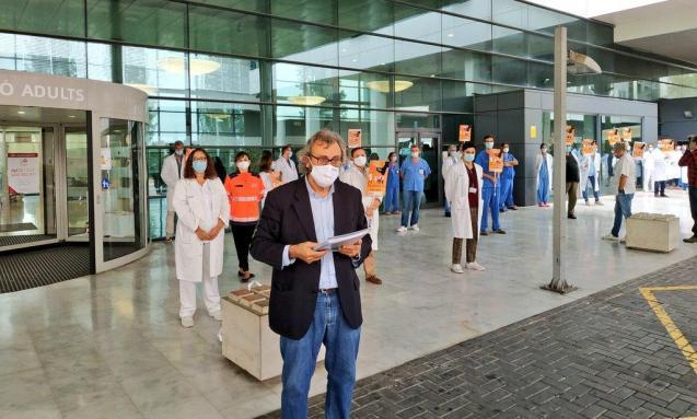 Doctors outside Son Espases Hospital in Palma, Mallorca