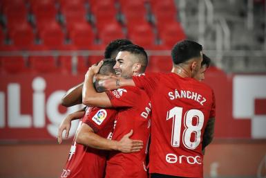 Real Mallorca's Dani Rodriguez is mobbed after scoring his second against Ponferradina.