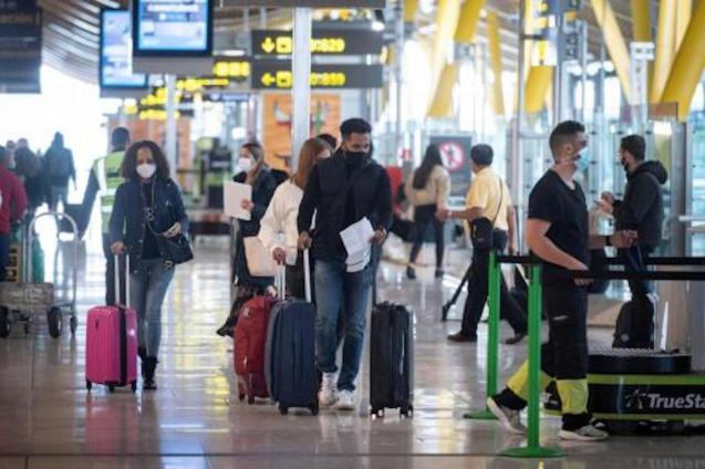 Passengers arriving at the airport in Spain.