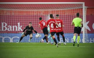 Real Mallorca's man of the match Manolo Reina (L) makes a one-handed stop