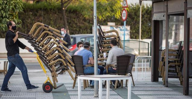 People sitting outside on a terrace
