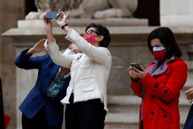 The ministers taking selfies including Arancha González Laya in the centre in Palma.