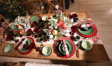 A Christmas table set for six people.
