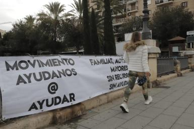 A banner over the Riera torrent in central Palma.