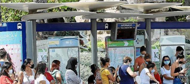 People waiting at a bus stop in Palma, Mallorca