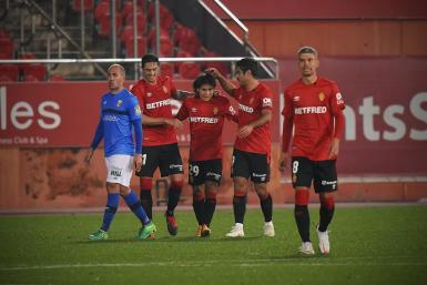 Luka Romero (no. 29) is congratulated after scoring his first professional goal for Real Mallorca.