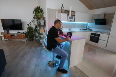 Ander Echevarria, founder of the building company specialised in all-wood, low-emission homes 100x100 Madera, checks the air quality in his house with an application installed on an iPad, in Guadalix de la Sierra.