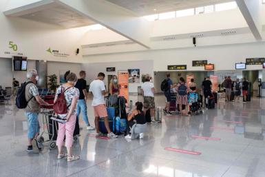 People at the airport in the Canary Islands.