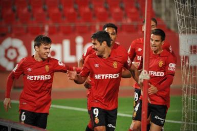 "Real Mallorca's Abdon Prats (no. 9, the ""Arta Assassin"") celebrates his double."