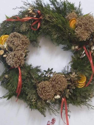 Here's one I made with greenery from the garden and dried leek flowers.