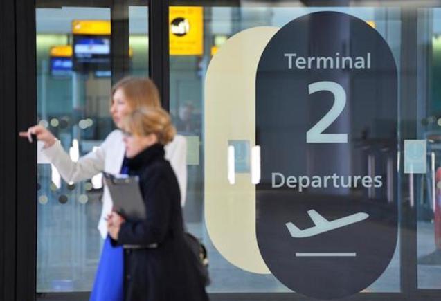 Passenger at Heathrow departures, London.