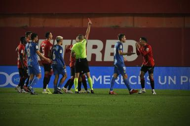 Real Mallorca's Cufre (R) gets his marching orders.