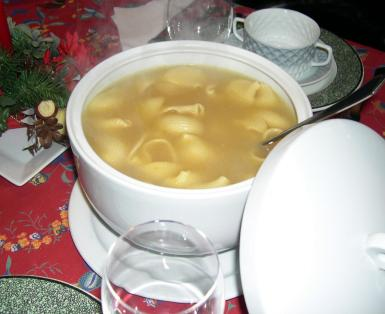 Sopa de Galets, large, shell shaped pasta stuffed with spiced mincemeat and served in a broth.