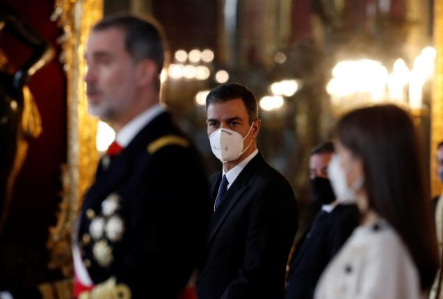 Prime Minister Pedro Sanchez looks on at King Felipe and Queen Letizia of Spain