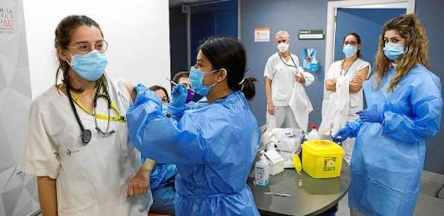 Nursing Home Healthcare Workers being immunised.