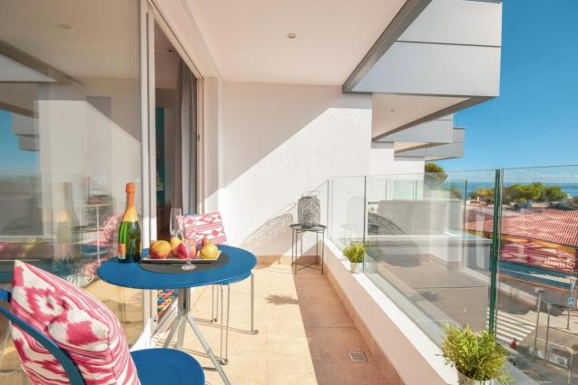The apartment has two private terraces overlooking the Palmanova bay