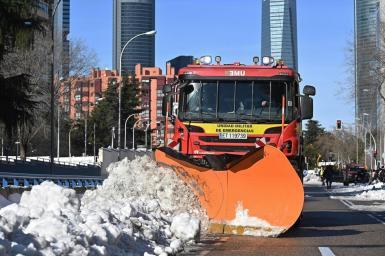 Cleaning the roads after the heavy snowfall caused by the Filomena storm in Madrid