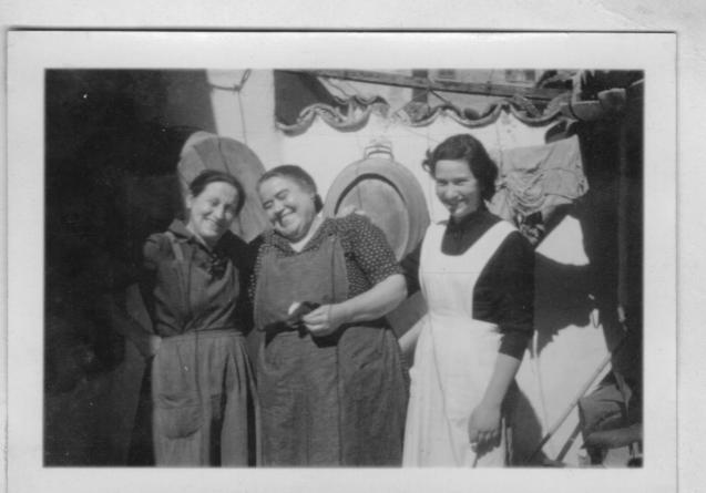 Maria Morey, current owner, with her mother and the author. The hostel's cook of the hostel, Madò Calona (in the centre), in 1957.