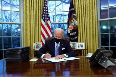 U.S. President Joe Biden signs executive orders.