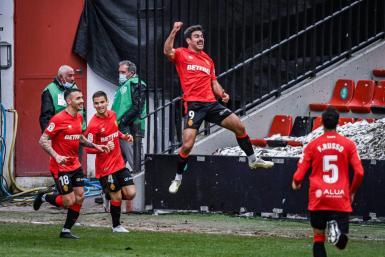 An airborne Abdon Prats celebrates his seventh goal in ten games.