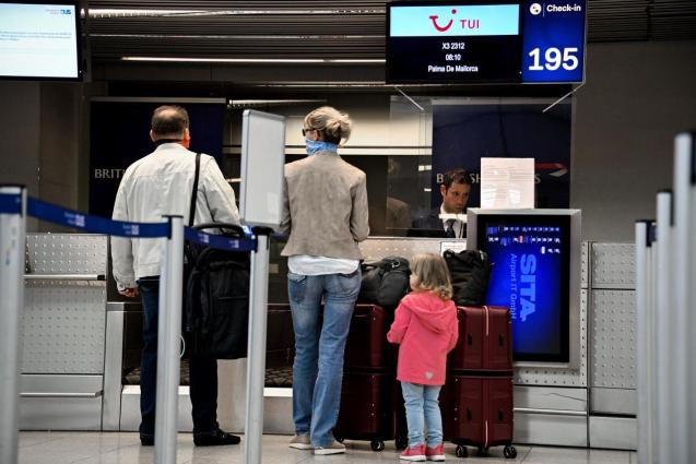Passengers checking in for a Palma flight