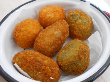 A serving of aubergine, spinach and bacalao croquettes.