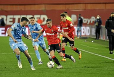 Dani Rodriguez (C) on his way to set up Mallorca's winning goal