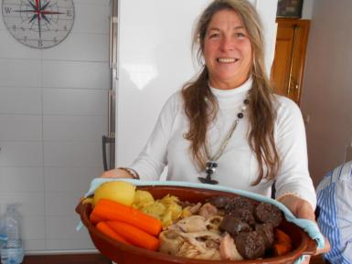 Claudia with her platter of cocido.