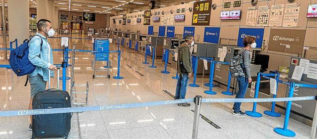 Passengers at airport check-in