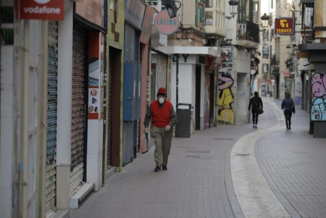 Elderly man wearing a mask in a street in Palma, Mallorca