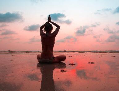 Doing yoga.