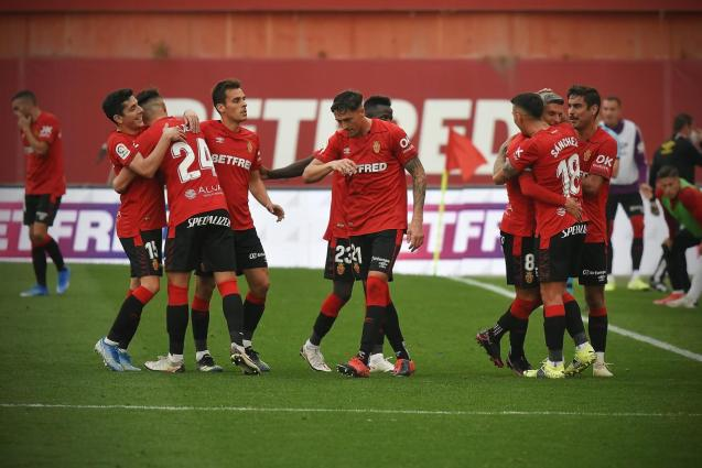 Salva Sevilla, Sanchez and Abdon Prats celebrate a goal