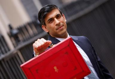 Britain's Chancellor of the Exchequer Rishi Sunak holds the budget box.