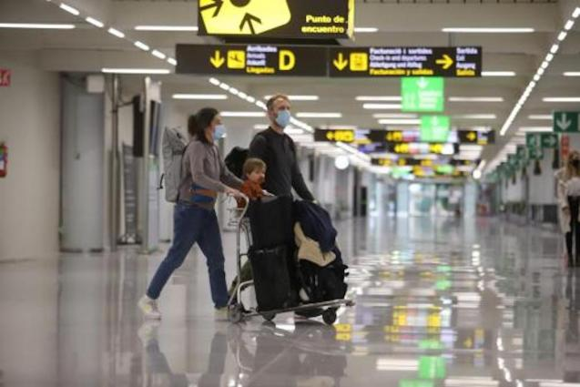 Travellers arriving at Palma Airport.