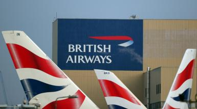 British Airways logos are seen on tail fins at Heathrow Airport in west London.