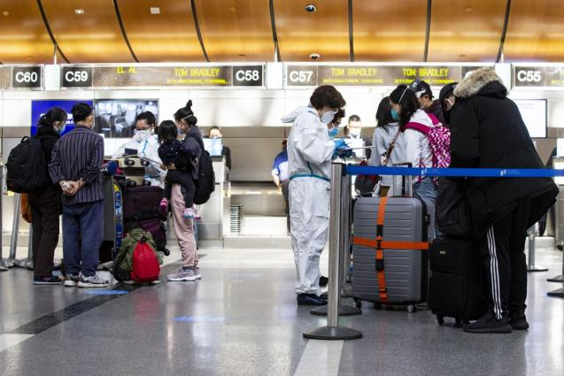 People travel from Los Angeles Airport amid coronavirus pandemic