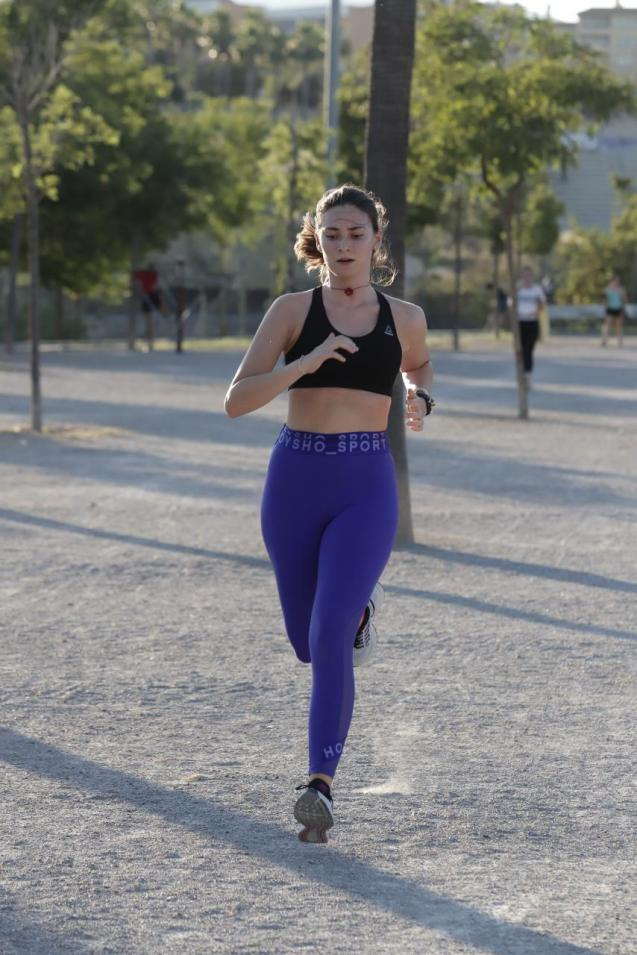 Woman running in Parc de Sa Riera