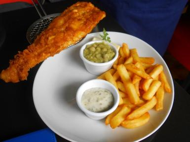 The fish and chips with mushy peas and tartare sauce.