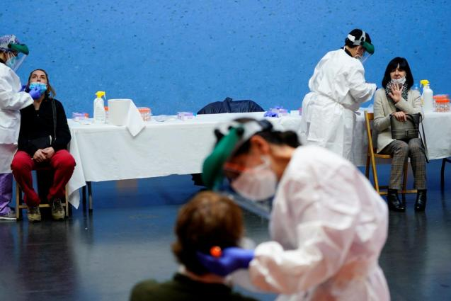 Nurses conduct a PCR tests on residents of the Basque town of Elorrio during mass testing
