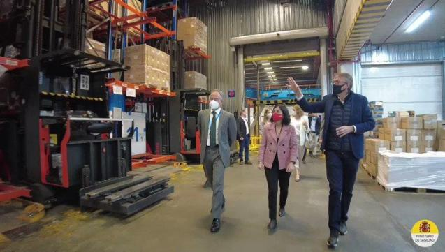 Spain's health minister at vaccine storage facility
