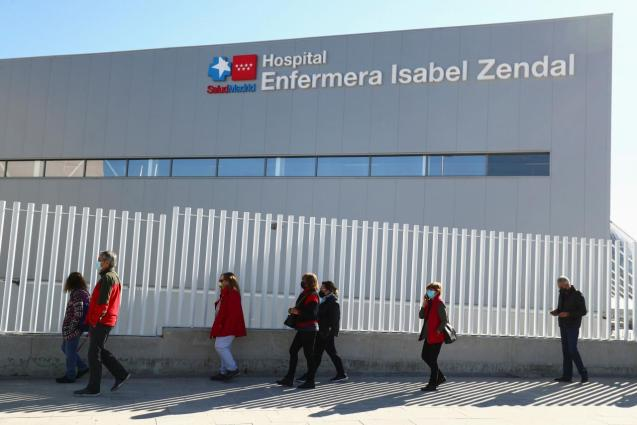 People wait in queue before receiving their first dose of the AstraZeneca COVID-19 vaccine in Madrid