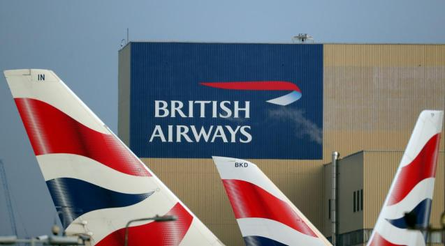 British Airways logos are seen on tail fins at Heathrow Airport in west London