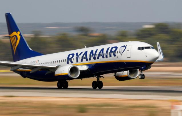 A Ryanair Boeing 737 airplane takes off from the airport in Palma de Mallorca