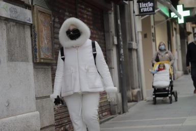 People wearing winter coats in Palma.