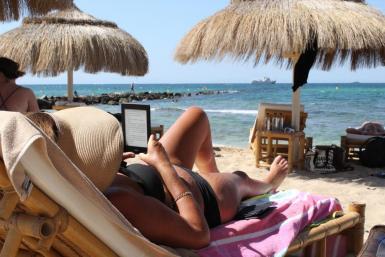 A tourist on the beach on Mallorca.
