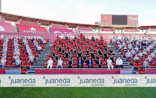 100 fans in an official squad photo for the season