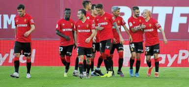 Mallorca players celebrate Victor Mollejo's (R) goal.